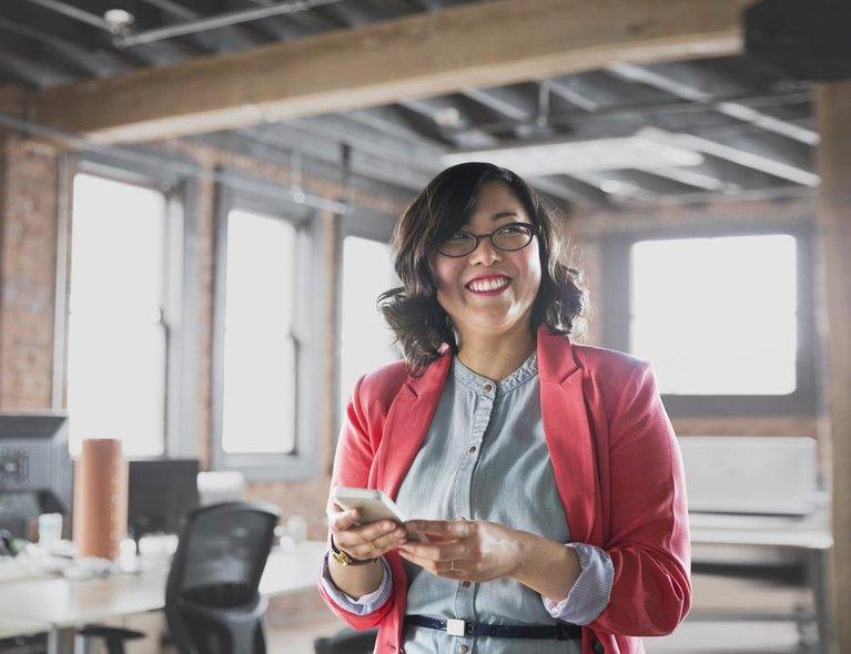 Services-NetworkServices2-DedicatedInternetAccess-WomanPhoneBrickOffice.jpg